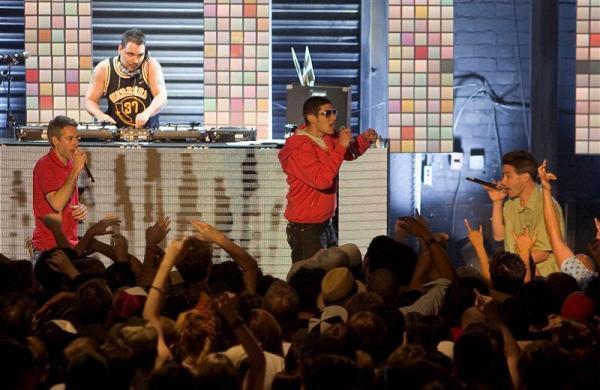 The Beastie Boys, (L-R) Adam Yauch, Michael Diamond, and Adam Horovitz, with DJ, Mix Master Mike behind them, perform in Las Vegas, June 9, 2004.