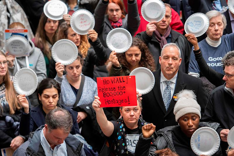 Federal employees holding empty plates stage a rally to call for a vote on the shutdown on Capitol Hill in Washington, DC, on Jan. 23, 2019.