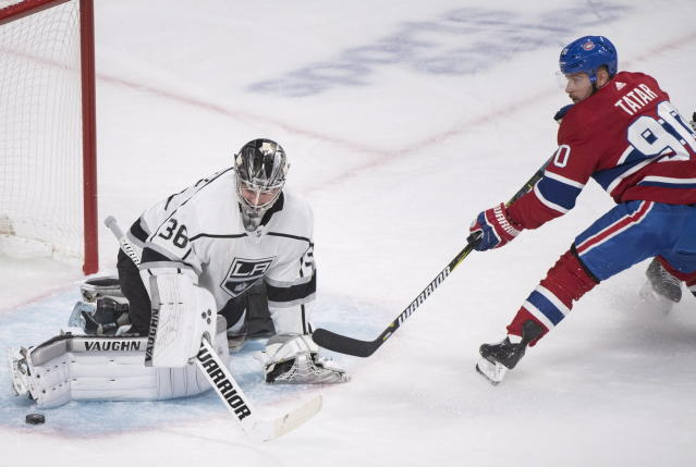 Los Angeles Kings goaltender Jack Campbell makes a save against Montreal Canadiens' Tomas Tatar during the first period of an NHL hockey game Thursday, Oct. 11, 2018, in Montreal. (Graham Hughes/The Canadian Press via AP)