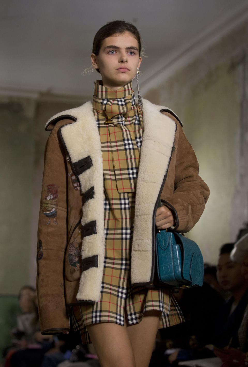 Burberry brought back the brand's signature check this season [Photo: PA]