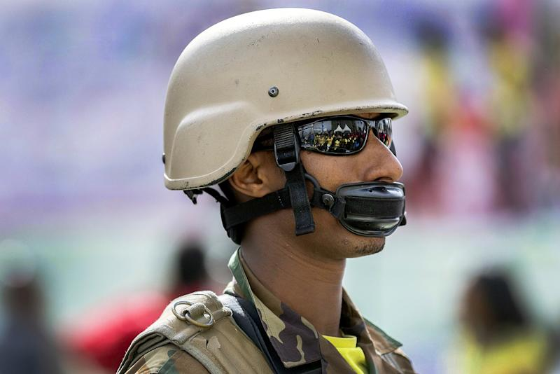 ETHIOPIA: A soldier creates a makeshift mask with his helmet's chinstrap to protect against the coronavirus in Addis Ababa.