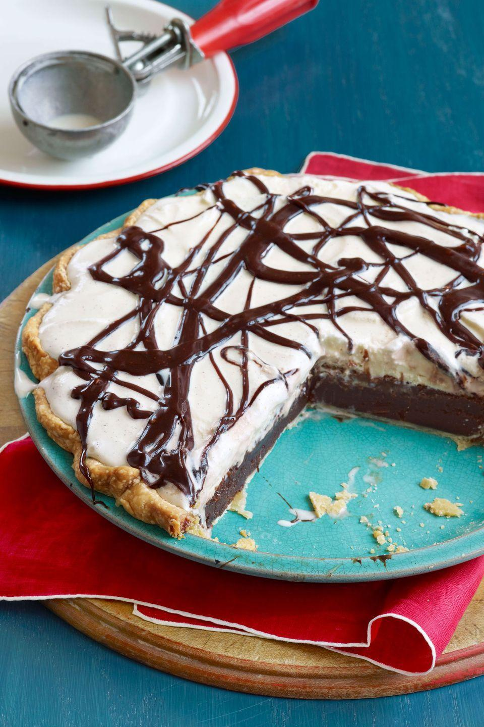 "<p>Create this mouthwatering pie with a layer of <a href=""https://www.countryliving.com/food-drinks/recipes/a1799/chocolate-custards-3920/"" rel=""nofollow noopener"" target=""_blank"" data-ylk=""slk:chocolate custard"" class=""link rapid-noclick-resp""><strong>chocolate custard</strong></a>, vanilla ice cream, and a drizzle of rich fudge sauce. </p><p><strong><a href=""https://www.countryliving.com/food-drinks/recipes/a3380/mississippi-mud-pie-recipe-clv0510/"" rel=""nofollow noopener"" target=""_blank"" data-ylk=""slk:Get the recipe."" class=""link rapid-noclick-resp"">Get the recipe.</a></strong></p>"