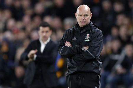 Middlesbrough caretaker manager Steve Agnew as Hull City manager Marco Silva looks on