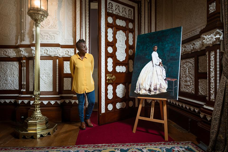 Artist Hannah Uzor with her painting of Sarah Forbes Bonetta, Queen Victoria's African goddaughterPA