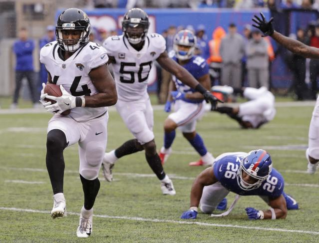 New York Giants' Saquon Barkley (26) watches as Jacksonville Jaguars' Myles Jack runs back an interception for a touchdown during the second half of an NFL football game Sunday, Sept. 9, 2018, in East Rutherford, N.J. (AP Photo/Seth Wenig)