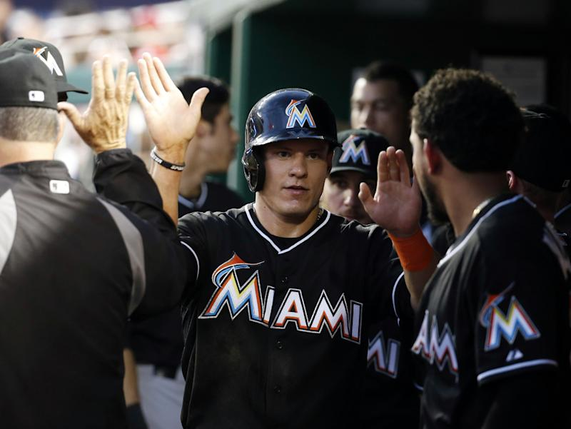Four-run 10th lifts Marlins over Nationals 8-5