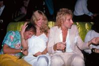 <p>Alana Hamilton and Rod Stewart sit on one of Studio 54's cheetah print couches with Steve Rubell. </p>