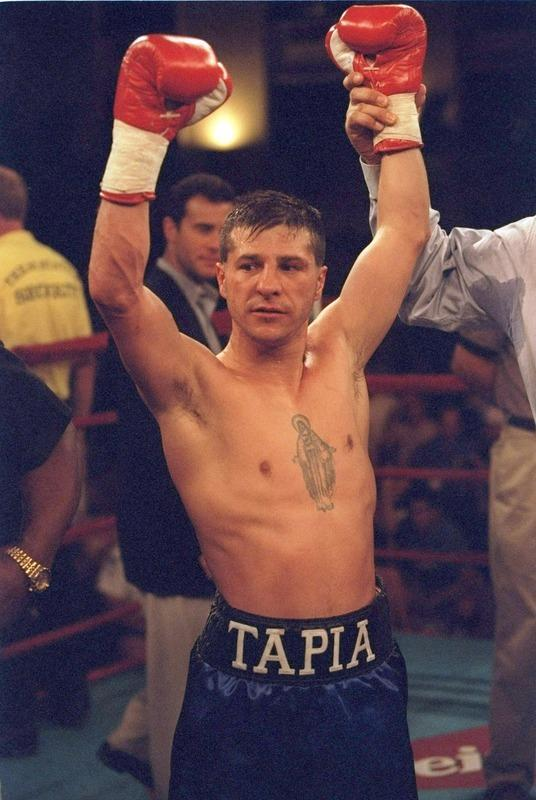 "11 Oct 1996: Johnny Tapia celebrates after a bout against Sammy Stewart at Texas Station in Las Vegas, Nevada. Tapia won the fight with a TKO in the seventh round. Johnny Tapia has been found dead at his home in Albuquerque, New Mexico at the age of 45. Police reports have stated that the death ""did not appear to be suspicious"". (Photo by Jed Jacobsohn/Getty Images)"