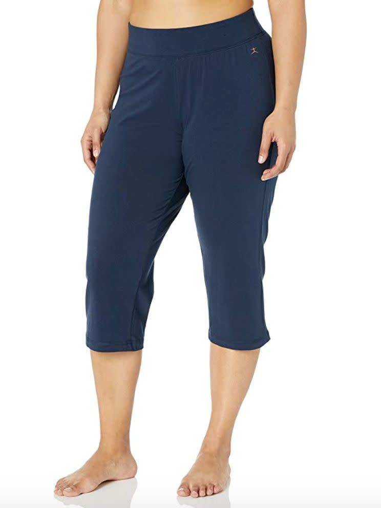 "These <a href=""https://amzn.to/3kDfuZb"" rel=""nofollow noopener"" target=""_blank"" data-ylk=""slk:crop pants"" class=""link rapid-noclick-resp"">crop pants</a> can work for any workout &mdash; or if you're just running errands! They feature a wide waistband and a 21-inch inseam. You can choose charcoal, navy or black. <br><br><strong>Sizes:</strong> These cropped pants come in sizes XS to 3X. <br><strong>Rating:</strong> They have a 4.2-star rating over more than 800 reviews. <br><strong>$$$:</strong> <a href=""https://amzn.to/3kDfuZb"" rel=""nofollow noopener"" target=""_blank"" data-ylk=""slk:Find them starting at $21 on Amazon"" class=""link rapid-noclick-resp"">Find them starting at $21 on Amazon</a>."