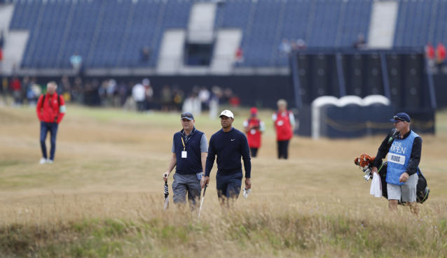 Tiger Woods of the United States walks the 3rd hols during a practice round for the 147th British Open Golf championships in Carnoustie, Scotland, Tuesday, July 17, 2018. The Open Golf championships starts Thursday. (AP Photo/Alastair Grant)