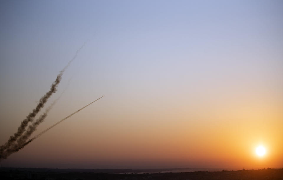 Rockets are launched from Gaza Strip to Israel, Tuesday, Nov. 12, 2019. Israel killed a senior Islamic Jihad commander in Gaza early Tuesday in a resumption of pinpointed targeting that threatens a fierce round of cross-border violence with Palestinian militants.(AP Photo/Khalil Hamra)
