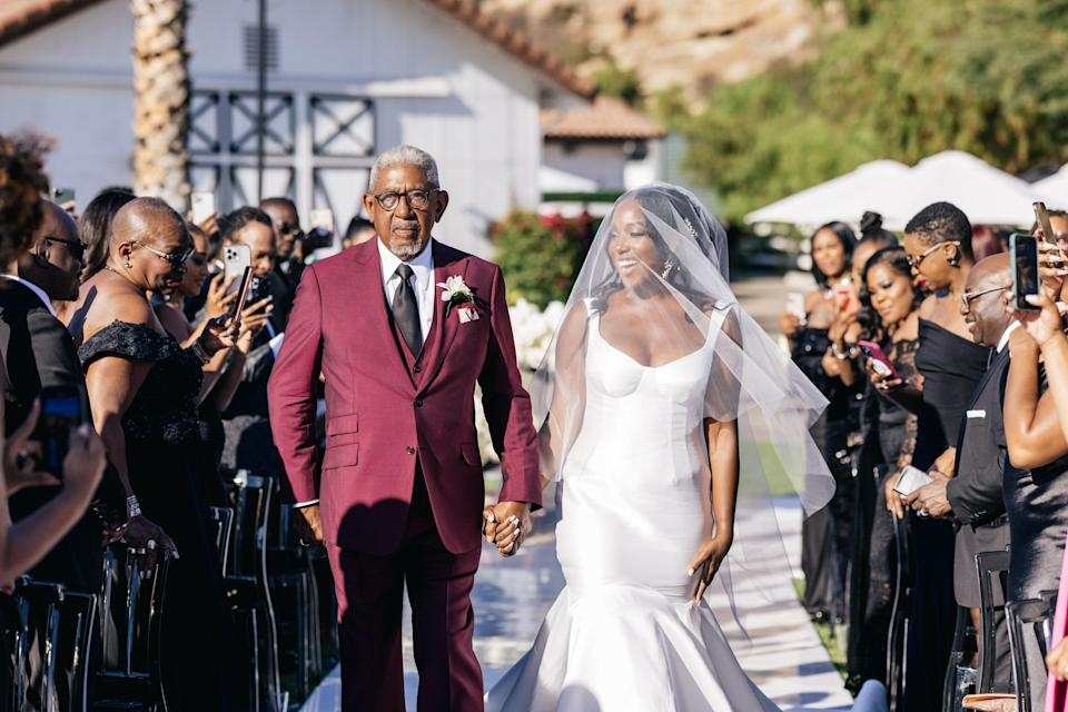 """I'll never forget this moment—walking down the aisle, hand and hand with my father. Just the way we always dreamed of. Oh, and I walked down the aisle to Lil Mo's """"4Ever"""" featuring Fabolous."""