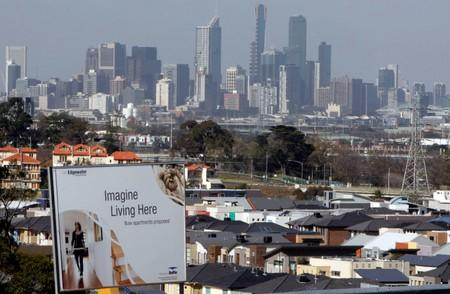 FILE PHOTO:  An advertising sign for a new housing development area is seen with the Melbourne skyline in the distance