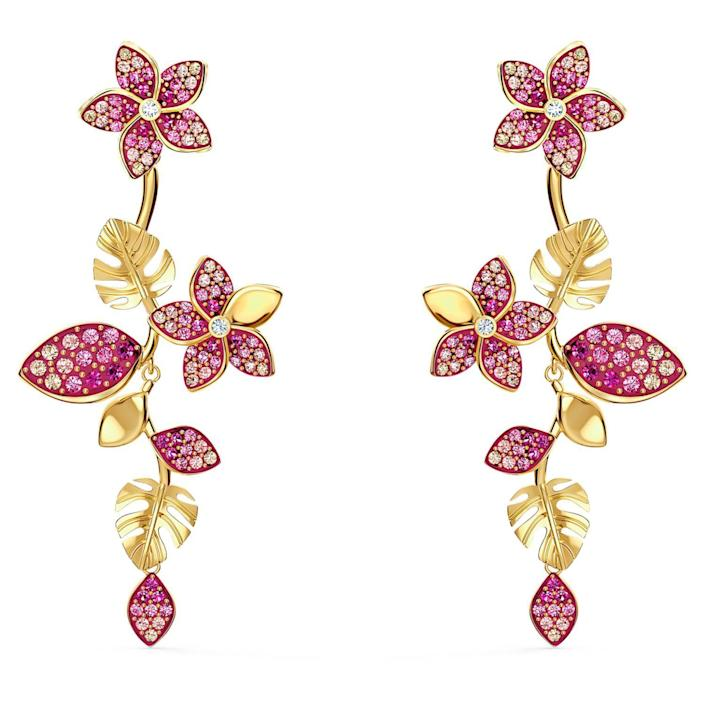 """<p><strong>SWAROVSKI</strong></p><p>amazon.com</p><p><strong>$129.22</strong></p><p><a href=""""https://www.amazon.com/dp/B085T2NBJY?tag=syn-yahoo-20&ascsubtag=%5Bartid%7C10056.g.36363979%5Bsrc%7Cyahoo-us"""" rel=""""nofollow noopener"""" target=""""_blank"""" data-ylk=""""slk:Shop Now"""" class=""""link rapid-noclick-resp"""">Shop Now</a></p><p>One-of-a-kind earrings for a one-of-a-kind woman, need we say more? </p>"""