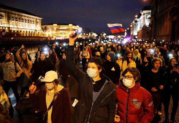 PHOTO: In this April 21, 2021, file photo, demonstrators march during a rally in support of jailed Russian opposition politician Alexei Navalny in Saint Petersburg, Russia. (Anton Vaganov/Reuters, FILE)