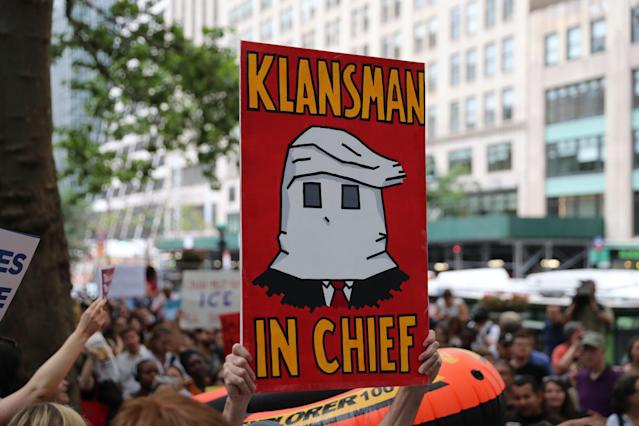 "<p>A protester holds up a sign depicting President Trump as a member of the KKK and reading ""Klansman in Chief""€ on the terrace outside the New York Public Library on 42nd Street in New York City on June 20, 2018. (Photo: Gordon Donovan/Yahoo News) </p>"