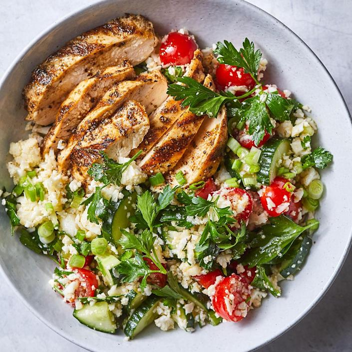 """<p>Chicken breasts on the grill have a smoky flavor that's enhanced with an easy spice rub. We chose flat-leaf parsley in this salad because it has a stronger herbal taste than its sometimes-bitter curly counterpart. <a href=""""https://www.eatingwell.com/recipe/279027/spiced-grilled-chicken-with-cauliflower-rice-tabbouleh/"""" rel=""""nofollow noopener"""" target=""""_blank"""" data-ylk=""""slk:View Recipe"""" class=""""link rapid-noclick-resp"""">View Recipe</a></p>"""