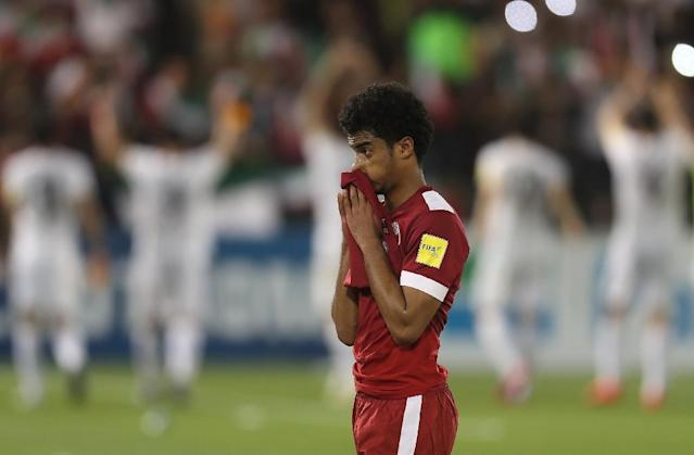 Qatar's Akram Hassan Afif reacts after losing their World Cup 2018 Asia qualifying football match against Iran at the Jassim Bin Hamad stadium in Doha on March 23, 2017 (AFP Photo/Karim JAAFAR)