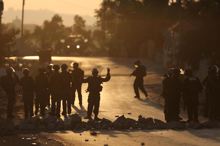 Israeli soldiers during clashes with Palestinian demonstrators in the West Bank village of Silwad on August 22, 2104 (AFP Photo/Abbas Momani)