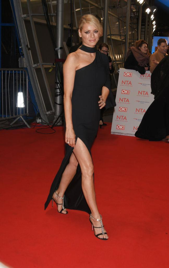 <p>Tess Daly stunned crowds at this year's National Television Awards in a one-shoulder LBD featuring a seriously sleek thigh-high split. <em>[Photo: Getty]</em> </p>