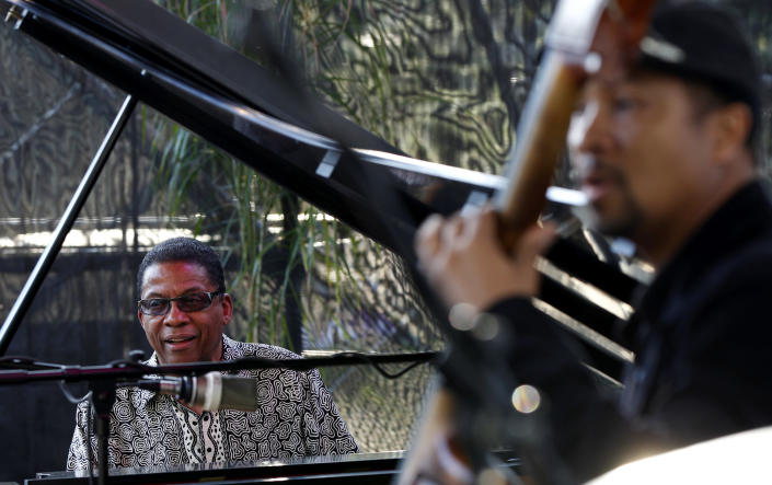 Herbie Hancock, left, and bassist Roland Guerin perform at a sunrise concert marking International Jazz Day in New Orleans, Monday, April 30, 2012. The performance, at Congo Square near the French Quarter, is one of two in the United States Monday; the other is in the evening in New York. Thousands of people across the globe are expected to participate in International Jazz Day, including events in Belgium, France, Brazil, Algeria and Russia. (AP Photo/Gerald Herbert)
