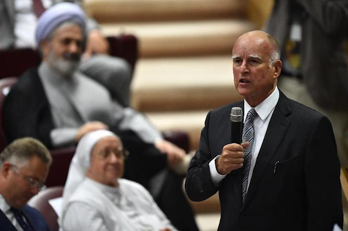 "The governor of California, Jerry Brown, speaks during a summit on ""Modern Slavery and Climate Change"" on July 21, 2015 at the Vatican (AFP Photo/Gabriel Bouys)"