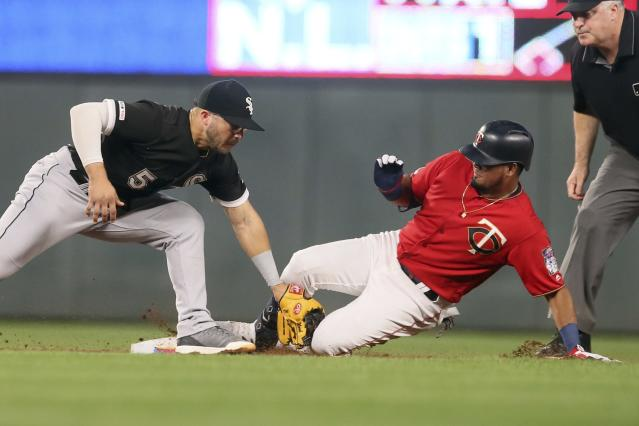 Minnesota Twins' Luis Arraez, right, beats the tag by Chicago White Sox second baseman Yolmer Sanchez to double in the third inning of a baseball game Tuesday, Sept. 17, 2019, in Minneapolis. (AP Photo/Jim Mone)