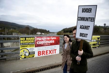 FILE PHOTO: People attend a protest against Brexit at the border crossing between the Republic of Ireland and Northern Ireland in Carrickcarnon