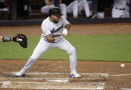 Miami Marlins' Caleb Smith bunts to bring in two runs during the second inning of a baseball game against the Arizona Diamondbacks, Monday, July 29, 2019, in Miami. (AP Photo/Lynne Sladky)