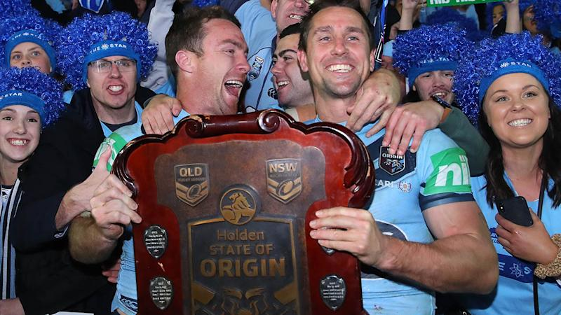 James Maloney and Mitchell Pearce celebrate with the State of Origin shield. (Photo by Cameron Spencer/Getty Images)