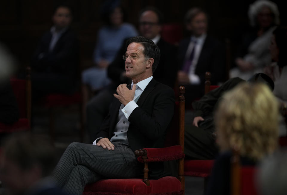 Caretaker Dutch Prime Minister Mark Rutte jokes prior to Dutch King Willem-Alexander's speech which marks the opening of the parliamentary year outlining the government's budget plans for the year ahead at the Grote Kerk, or Sint-Jacobus Kerk, (Great Church or St. James' Church) in The Hague, Netherlands, Tuesday, Sept. 21, 2021. (AP Photo/Peter Dejong)