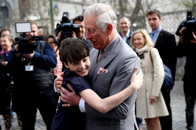 Prince Charles receives a hug from Valentine Blacker, during a visit to Bucharest, Romania. (Getty Images)