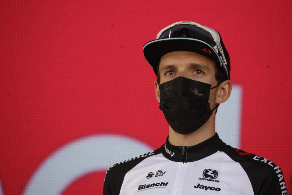 Britain's Simon Yates stands on podium after placing third in the Giro d'Italia cycling race in Milan, Italy, Sunday, May 30, 2021. (AP Photo/Luca Bruno)