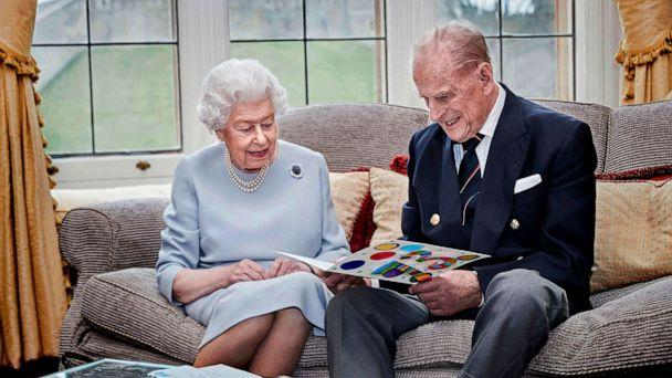 PHOTO: Britain's Queen Elizabeth and Prince Philip, Duke of Edinburgh look at their homemade wedding anniversary card in the Oak Room at Windsor Castle, Windsor, Britain, Nov. 17, 2020.  (Chris Jackson/Buckingham Palace/AFP via Getty )