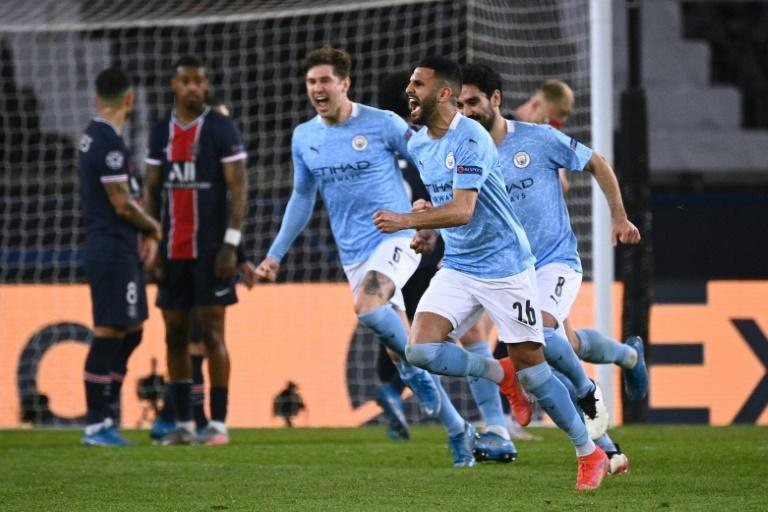 Riyad Mahrez celebrates after scoring Manchester City's winner in the first leg of their tie against PSG