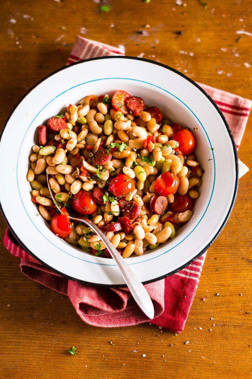 """<p>That liquid your canned beans and veggies are swimming in is mostly salt and starch. A strain followed by a quick 10-second rinse will remove about 40% of the sodium. Then you can """"add ½ cup to pretty much anything you're eating for lunch or dinner every day,"""" says <a href=""""https://www.thebloatedbellywhisperer.com/"""" rel=""""nofollow noopener"""" target=""""_blank"""" data-ylk=""""slk:Tamara Duker Freuman, R.D."""" class=""""link rapid-noclick-resp"""">Tamara Duker Freuman, R.D.</a>, author of <em>The Bloated Belly Whisperer</em>. Fold into sauces and salads, add to veggie side dishes, mix with ground meat, and more. """"Eating beans/legumes every day is the single common dietary factor among people who live the longest, most disease-free lives,"""" says Duker Freuman.</p>"""