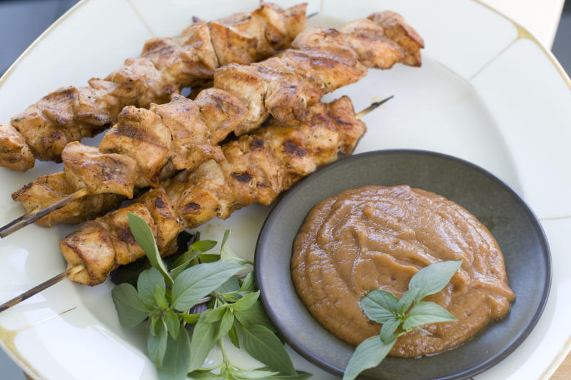In this Aug. 5, 2013 photo, chicken kebabs with chili banana sauce are shown, in Concord, N.H. (AP Photo/Matthew Mead)