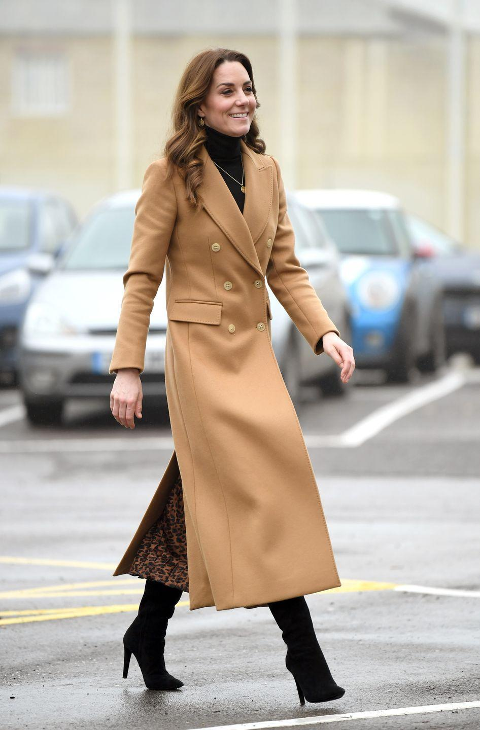 """<p>Kate Middleton chose a camel coat, heeled boots, skirt, and turtleneck for a visit to Wales. The Duchess was there <a href=""""https://www.townandcountrymag.com/society/tradition/a30613232/kate-middleton-survey-uk-tour-announcement/"""" rel=""""nofollow noopener"""" target=""""_blank"""" data-ylk=""""slk:to promote her new survey about early childhood development"""" class=""""link rapid-noclick-resp"""">to promote her new survey about early childhood development</a>.</p>"""