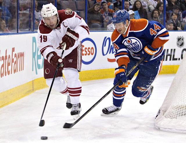 Phoenix Coyotes' Shane Doan (19) and Edmonton Oilers' Corey Potter (44) race for the puck during the first period of an NHL hockey game Friday, Jan. 24, 2014, in Edmonton, Alberta. (AP Photo/The Canadian Press, Jason Franson)