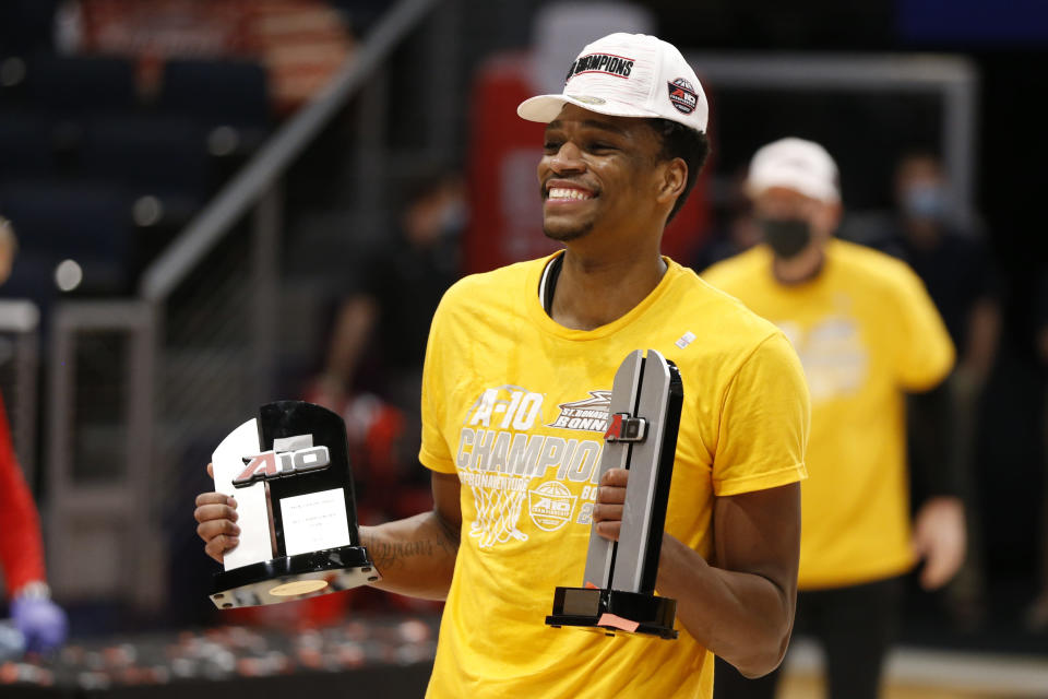 St. Bonaventure's Osun Osunniyi shows off his All-Tournament team and Most Outstanding Player awards after St. Bonaventure beat VCU in an NCAA college basketball championship game for the Atlantic Ten Conference tournament Sunday, March 14, 2021, in Dayton, Ohio. (AP Photo/Jay LaPrete)