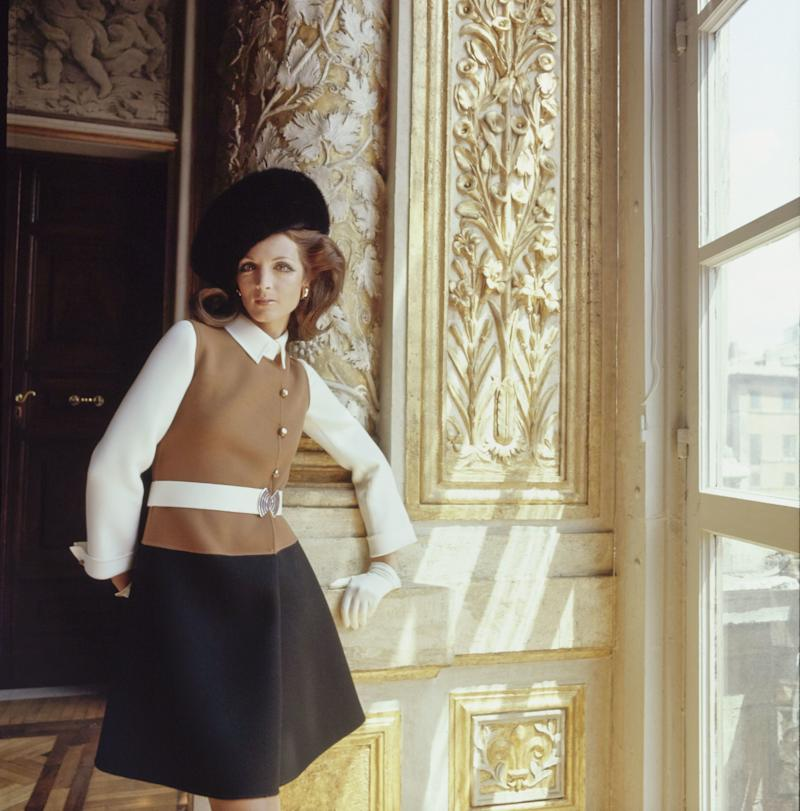"""Mila Schön's """"tricolored belted coatdress for a great day in town—black and white with a mock weskit of tan, gold-and-enamel buttons, and buckle. Agnona wool. Buckle, buttons by Loris Abate. Mila Schön hat."""""""
