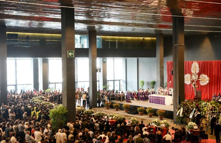 Thousands of mourners had packed into the exhibition hall to bid farewell to the victims