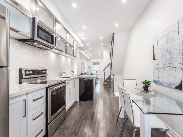 """<p><a rel=""""nofollow"""" href=""""https://www.zoocasa.com/toronto-on-real-estate/5560853-717-palmerston-ave-toronto-on-m6g2r2-c4237079"""">717 Palmerston Ave., Toronto, Ont.</a><br />The kitchen flows into the living and dining areas.<br />(Photo: Zoocasa) </p>"""