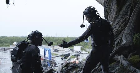 """Publicity photo of actors Toby Kebbell and Andy Serkis in their roles in """"Dawn of the Planet of the Apes"""""""