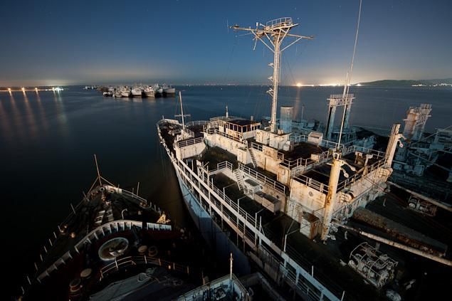 In Suisun Bay, 30 miles northeast of San Francisco, there lies a vast ghostly fleet of almost 100 abandoned Navy and merchant ships.  These vessles, known as the Mothball Fleet, served in four US wars and are currently awaiting disposal.  (Photo courtesy Scott Haefner/Scotthaefner.com)