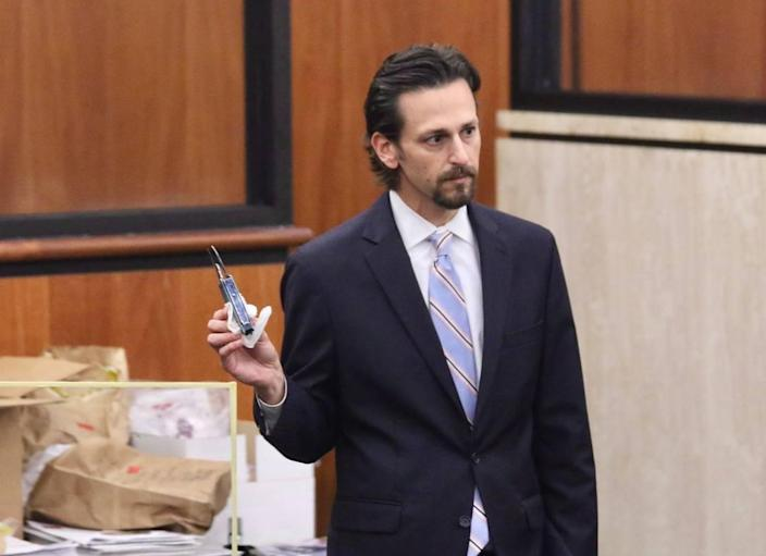 Prosecutor Dan Goldberg shows a multi-tool that prosecutors have entered into evidence in the murder trial for Nathaniel Rowland, accused of killing USC student Samantha Josephson, during the trial on Friday, July 23, 2021.