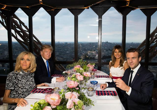 <p>President Donald Trump, first lady Melania Trump, French President Emmanuel Macron his wife Brigitte Macron, sit for dinner at the Jules Verne Restaurant on the Eiffel Tower in Paris, Thursday, July 13, 2017. (Photo: Carolyn Kaster/AP) </p>