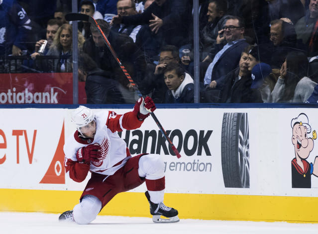 Detroit Red Wings center Dylan Larkin (71) reacts after scoring in overtime NHL against the Toronto Maple Leafs in Toronto on Thursday, Dec. 6, 2018. (Nathan Denette/The Canadian Press via AP)