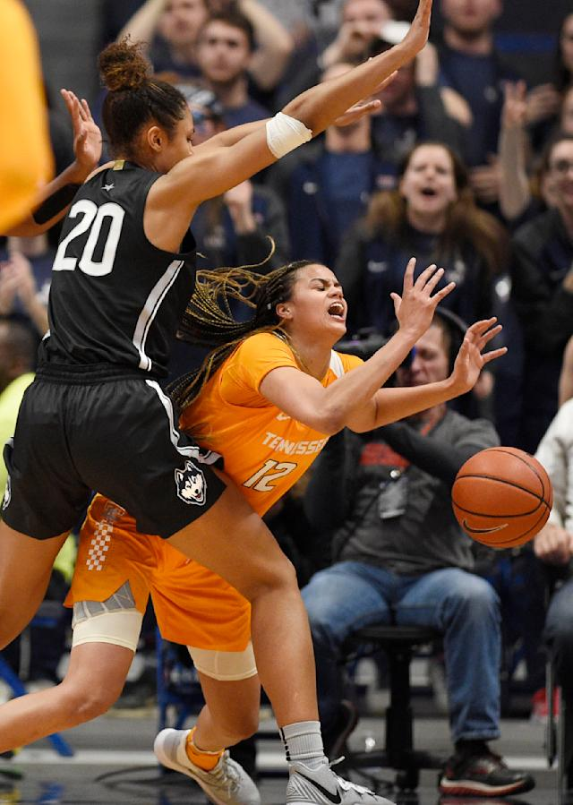 Tennessee's Rae Burrell (12) loses the ball under pressure from Connecticut's Olivia Nelson-Ododa (20) in the second half of an NCAA college basketball game, Thursday, Jan. 23, 2020, in Hartford, Conn. (AP Photo/Jessica Hill)