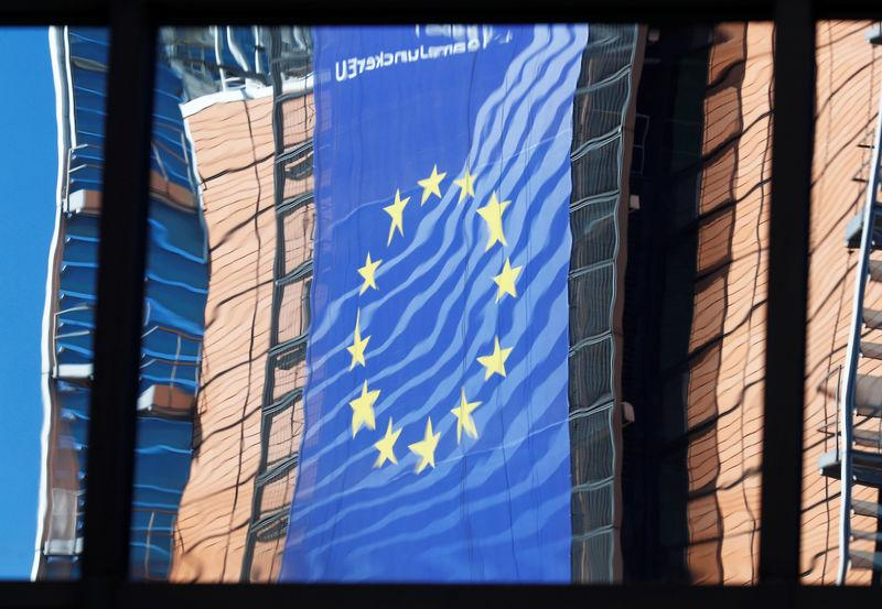 FILE PHOTO: The facade of the EU Commission headquarters is reflected in the windows of the EU Council building in Brussels